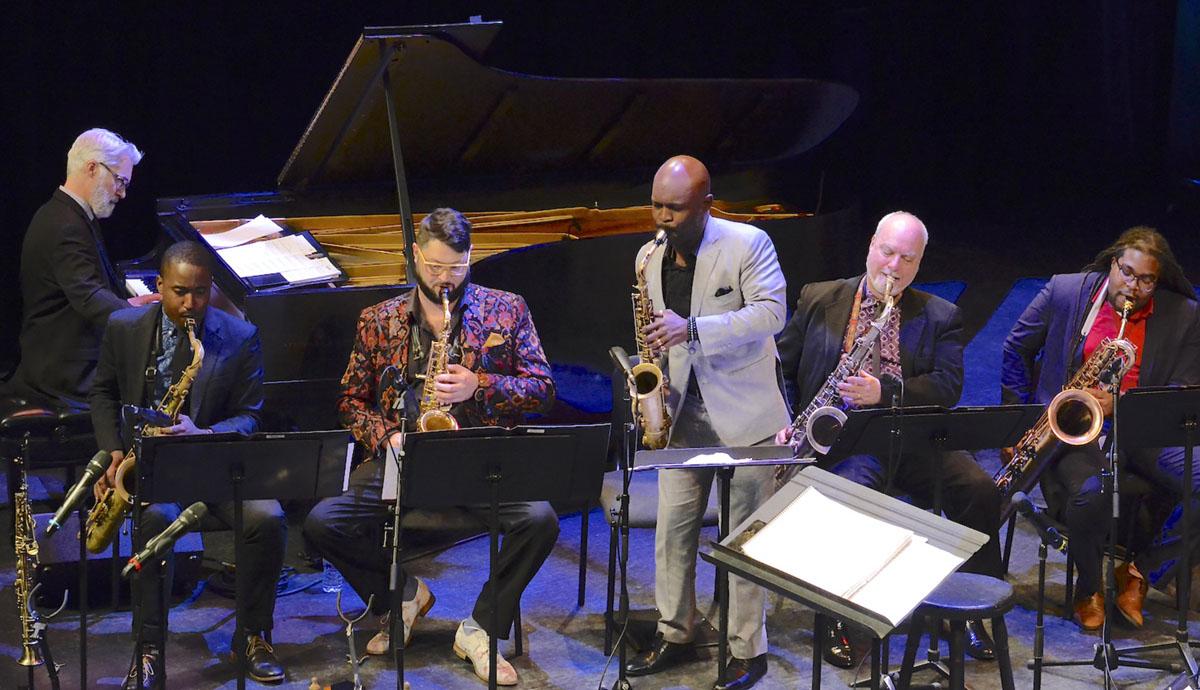Victor Atkins (piano), Khari Allen Lee and the saxophones section. Photo credit- Atael Weissman